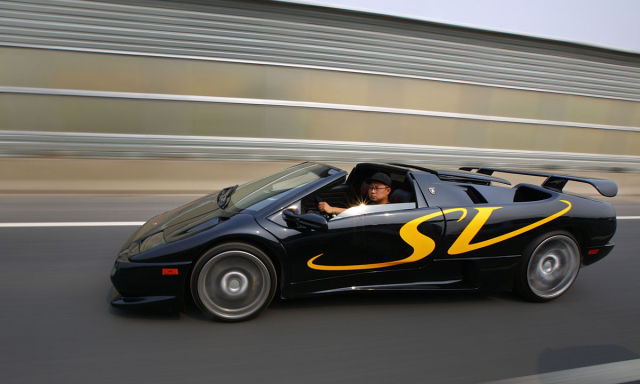Wang drives a handmade replica of Lamborghini Diablo on a highway during a test drive in Beijing